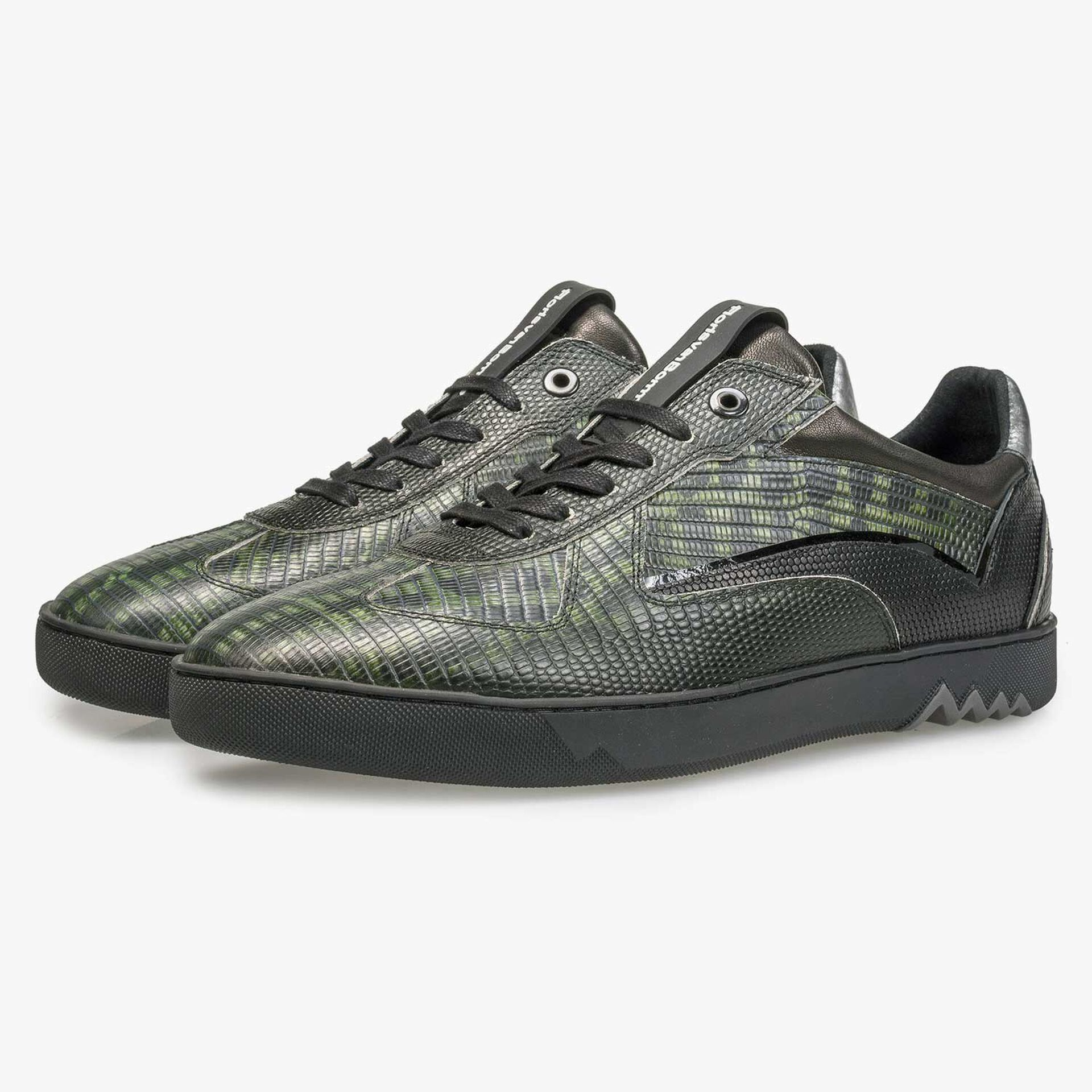 Sneaker with a lizard relief pattern