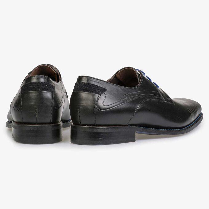 Black lace shoe with laser-cut print