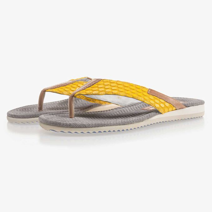Yellow, printed thong slipper made of leather