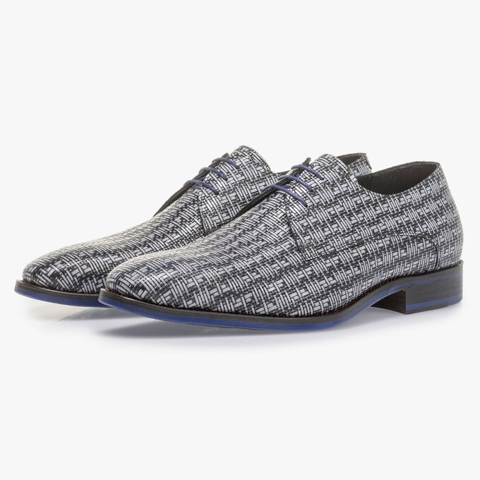 Grey lace shoe with a black graphic print