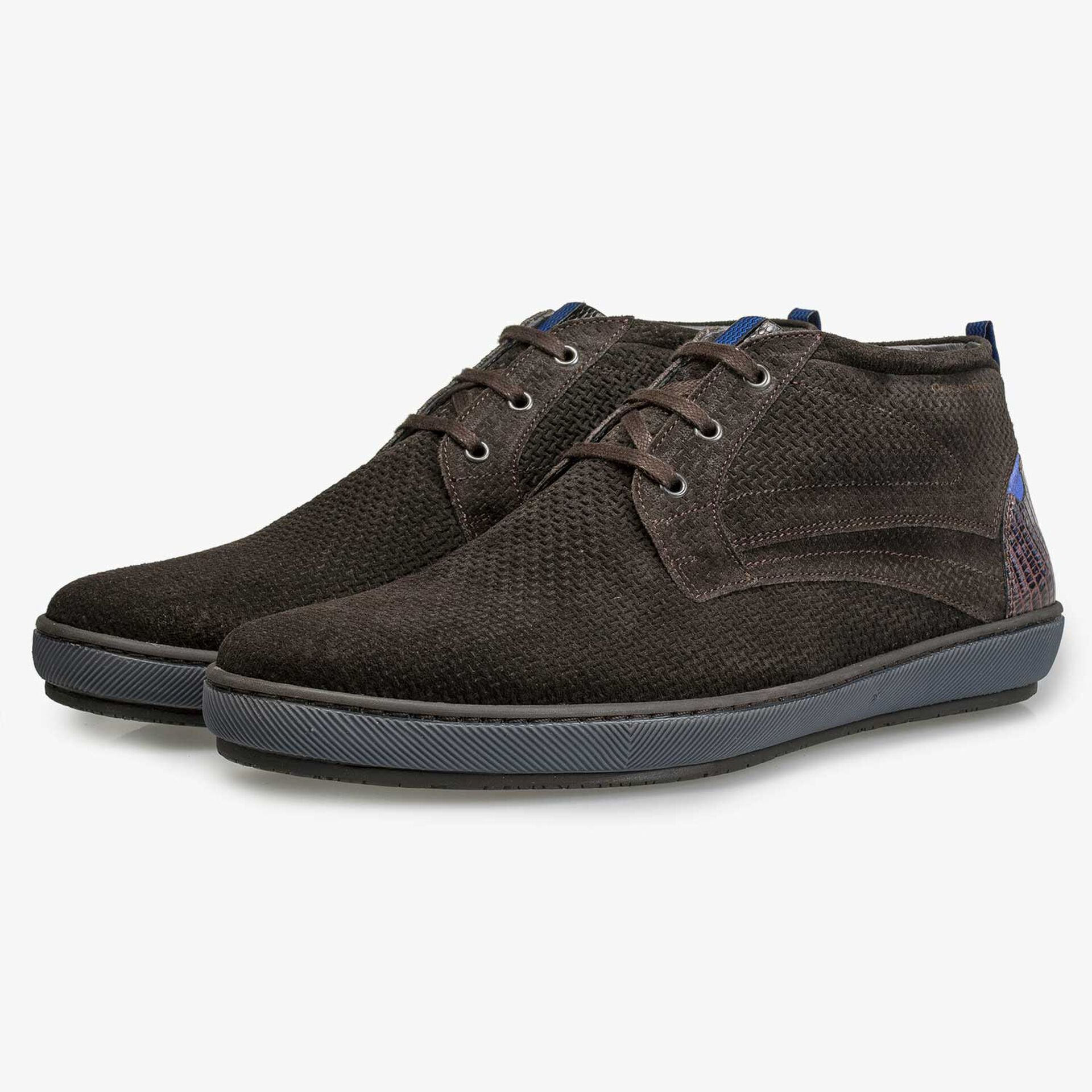 Mid-high dark brown lace boot with structural pattern