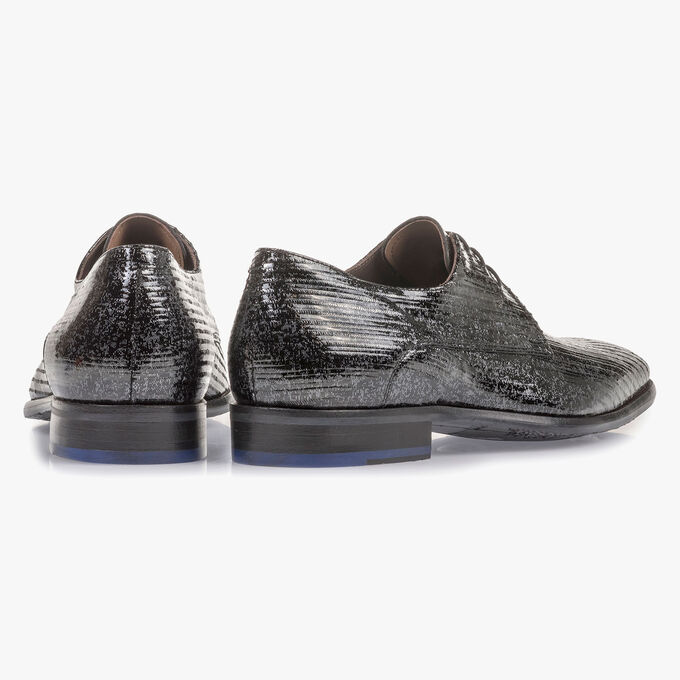 Black patent leather lace shoe with metallic print