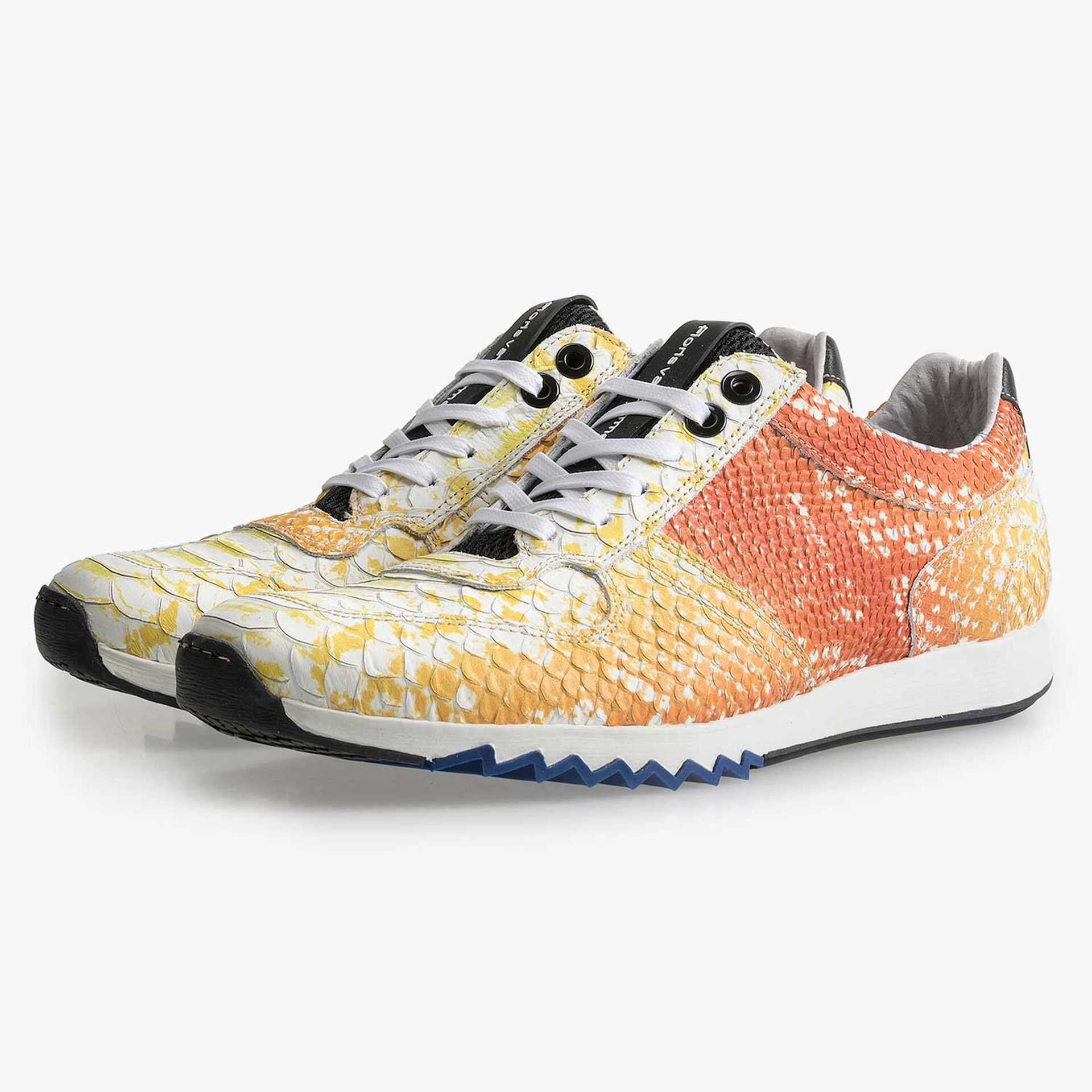 Yellow leather sneaker with a snake pattern