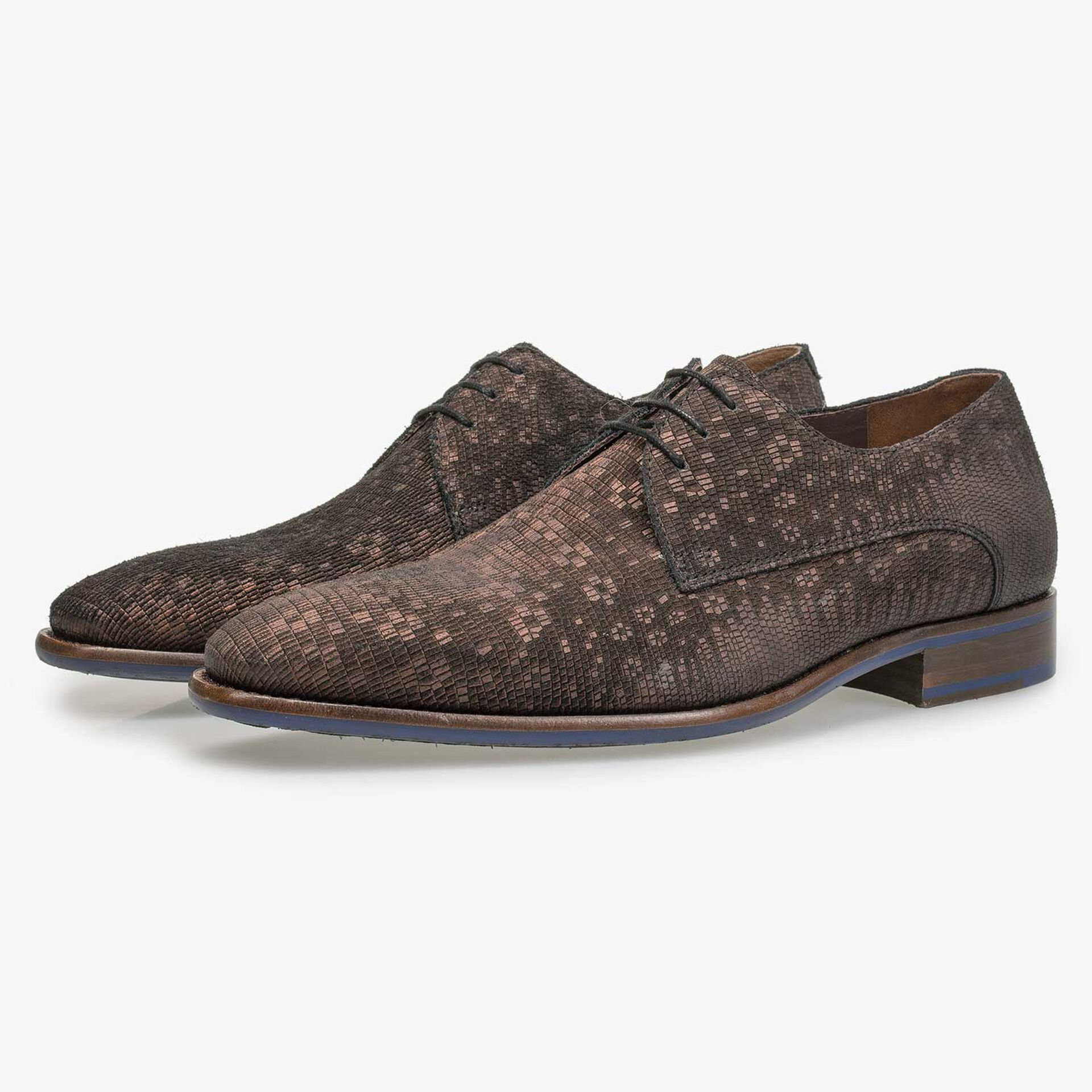 Brown lace shoe with structural pattern