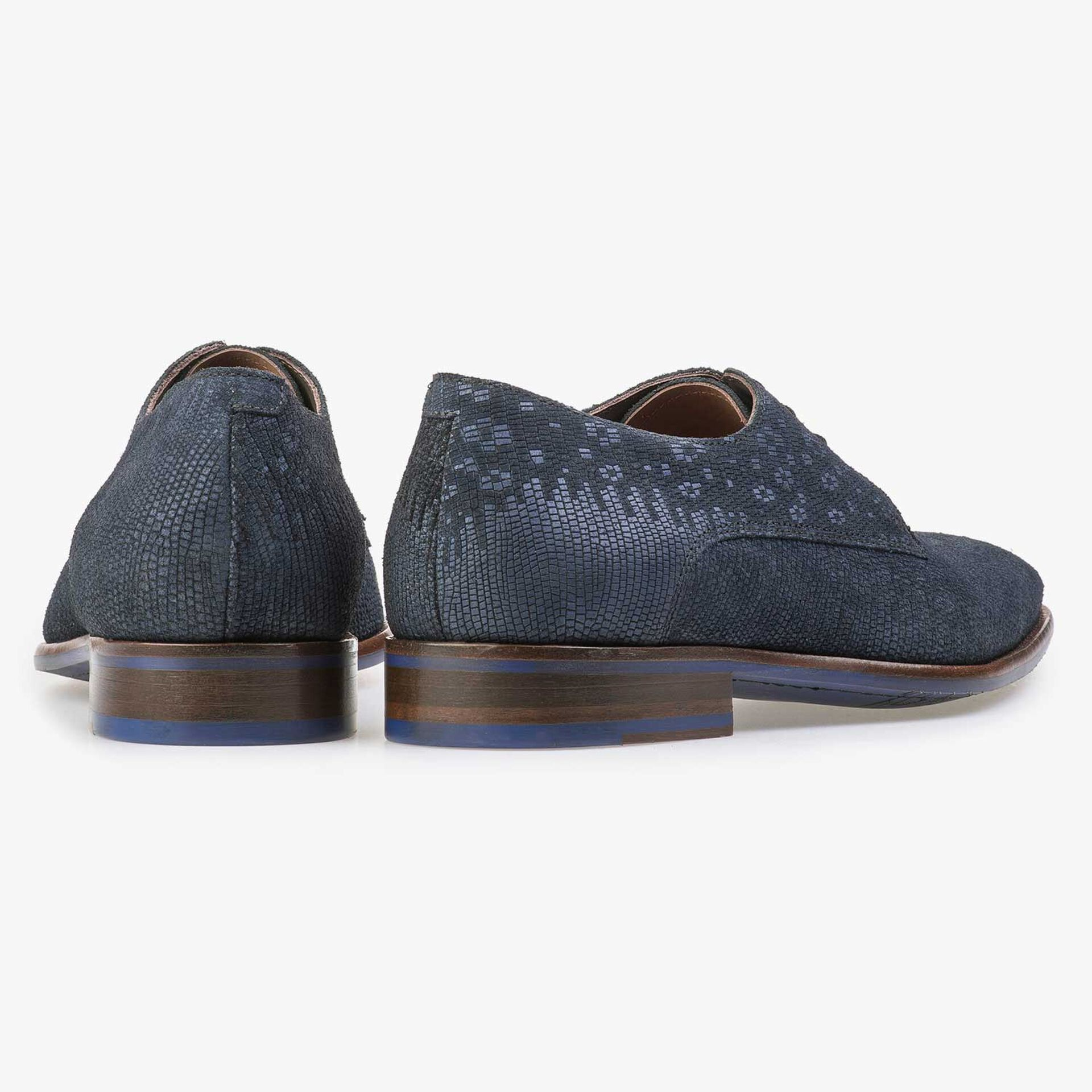 Blue lace shoe with structural pattern