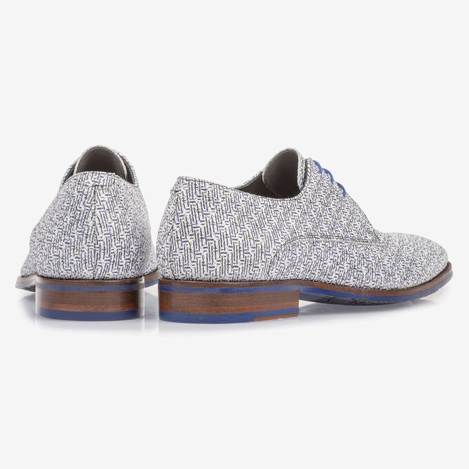 White leather lace shoe with blue print