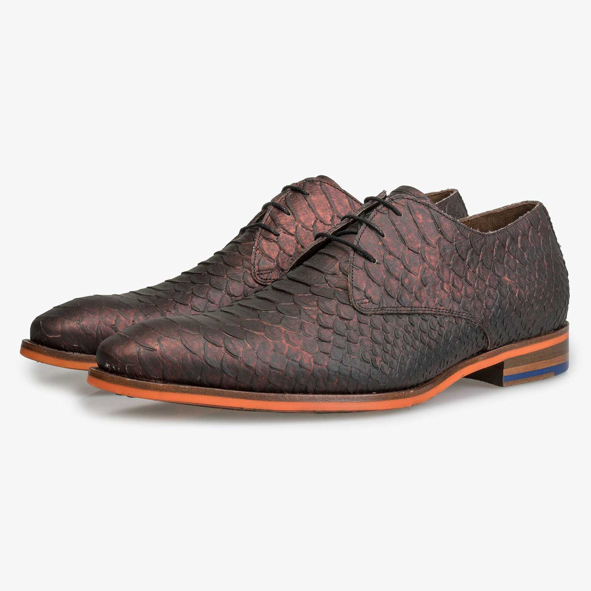 Leather lace shoe with snake print and orange outsole